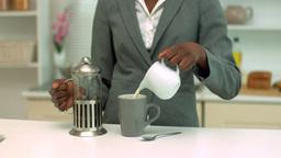Woman making coffee at breakfast Footage