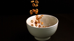 Circular cereal being poured into a bowl Footage