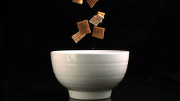 Square cereal falling into bowl Footage