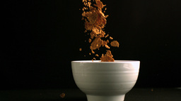 Brown cereals pouring in a bowl Footage