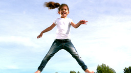 Child jumping on a trampoline Stock Video Footage