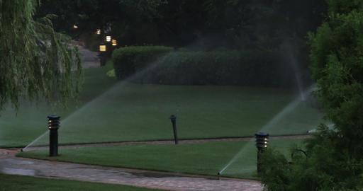 1927 Sprinkler System Watering Lawn, 4K Footage