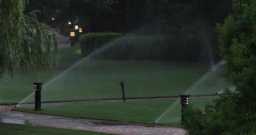 1927 Sprinkler System Watering Lawn, 4K Stock Video Footage