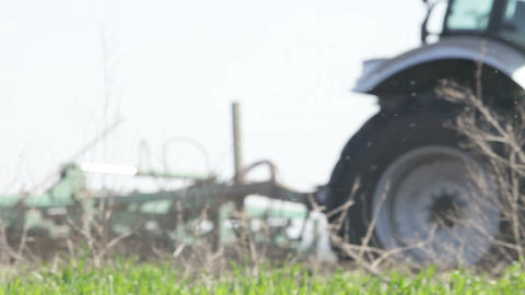 gray tractor go on black earth field Stock Video Footage
