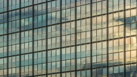 4K Office building facade mirroring DSLR time laps Stock Video Footage