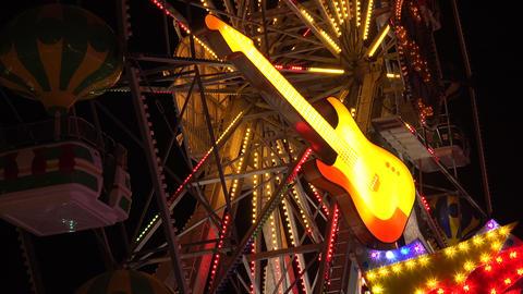 Neon guitar. Golden Sands. Resort in Bulgaria. 4K Footage