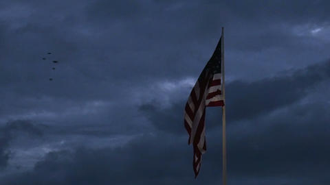 1986 American Flag at Dusk with Birds Flying by in Footage