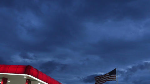 1988 American Flag next to Gas Station at Dusk, HD Stock Video Footage