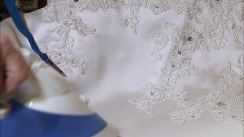 woman ironed white wedding dress Footage