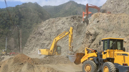 Front End Loader And Diggers Move Rocks And Earth  stock footage