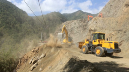 Front End Loader And Diggers Widen Main Road stock footage