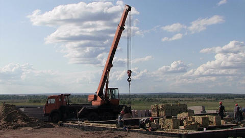 Working Crane At A Construction Site stock footage