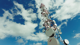 4K Communication Tower With Clouds Timelapse stock footage