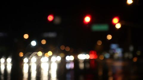 rainy night traffic at intersection Footage