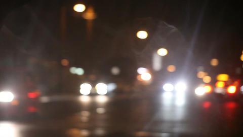 turning on a street corner on a rainy night Footage