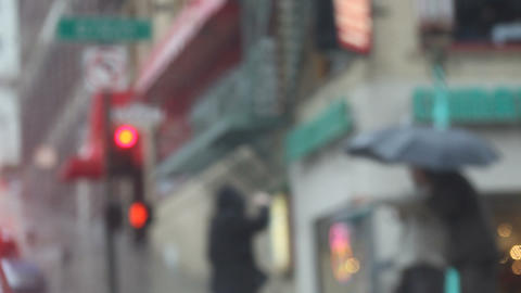 pedestrians in Chinatown in the rain Footage
