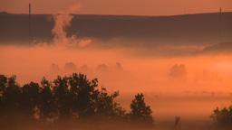 HD2008-7-1-15 sunrise fog gas plant Stock Video Footage