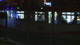 HD2008-7-2-39 LRT arrives stn night Stock Video Footage