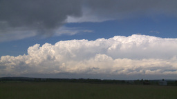 HD2008-6-7-1 distant tstorm and field Stock Video Footage