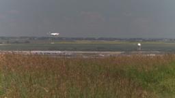 HD2008-7-10-6 wild grass blowing in wind 737 thru frame Footage