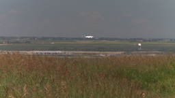 HD2008-7-10-6 wild grass blowing in wind 737 thru frame Stock Video Footage
