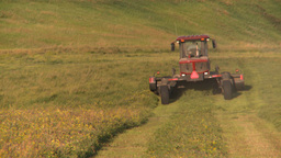 HD2008-7-14-50 tractor harvesting timothy hay Stock Video Footage