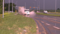 HD2008-7-15-7 raain flooded road truck splash Footage