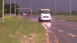 HD2008-7-15-7 raain flooded road truck splash Stock Video Footage