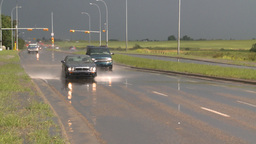 HD2008-7-15-9 rain flooded road truck and cars splash Stock Video Footage