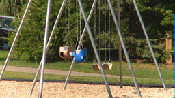 HD2008-7-17-9 empty kids playground swing set Stock Video Footage