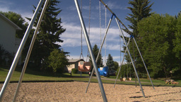HD2008-7-17-15 empty kids playground swingset Stock Video Footage