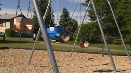 HD2008-7-17-17 empty kids playground swingset Stock Video Footage