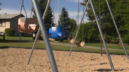HD2008-7-17-17 empty kids playground swingset Stock Video Footage