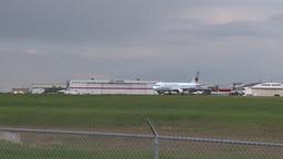 HD2008-6-1-14 AC airbus jet lands thru frame Stock Video Footage