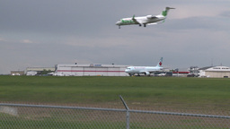 HD2008-6-1-14 AC airbus jet lands thru frame Stock Video Footage