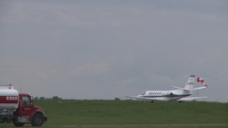 HD2008-6-1-22 Cessna citation takeoff trucks Stock Video Footage