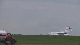 HD2008-6-1-22 Cessna citation takeoff trucks Footage