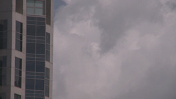 HD2008-6-1-34 TL clouds bdg plane thru frame Stock Video Footage