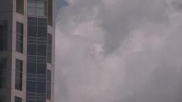 HD2008-6-1-34 TL clouds bdg plane thru frame Stock Video Footage