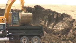 HD2008-6-5-14 backhoe and dumptruck Footage