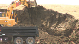 HD2008-6-5-14 backhoe and dumptruck Stock Video Footage