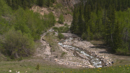 HD2008-6-5-30 mtn stream z to mtns Stock Video Footage