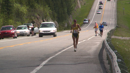 HD2008-6-5-46 jogger on highway Stock Video Footage