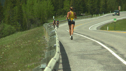 HD2008-6-5-48 jogger cyclist on highway Stock Video Footage
