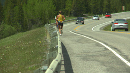 HD2008-6-5-48 jogger cyclist on highway Footage