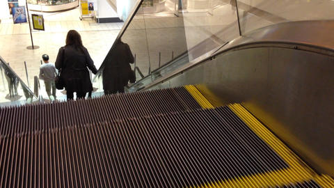 People climb the escalator Footage