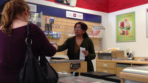 Couple mailing letter at post office Stock Video Footage