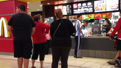 Family ordering food at McDonalds Footage