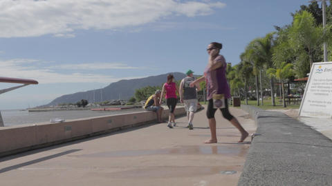 Cinematic Dolly Shot People Walking At Cairns Espl stock footage