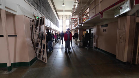 Tourists Go Inside Alcatraz Prison Cell stock footage